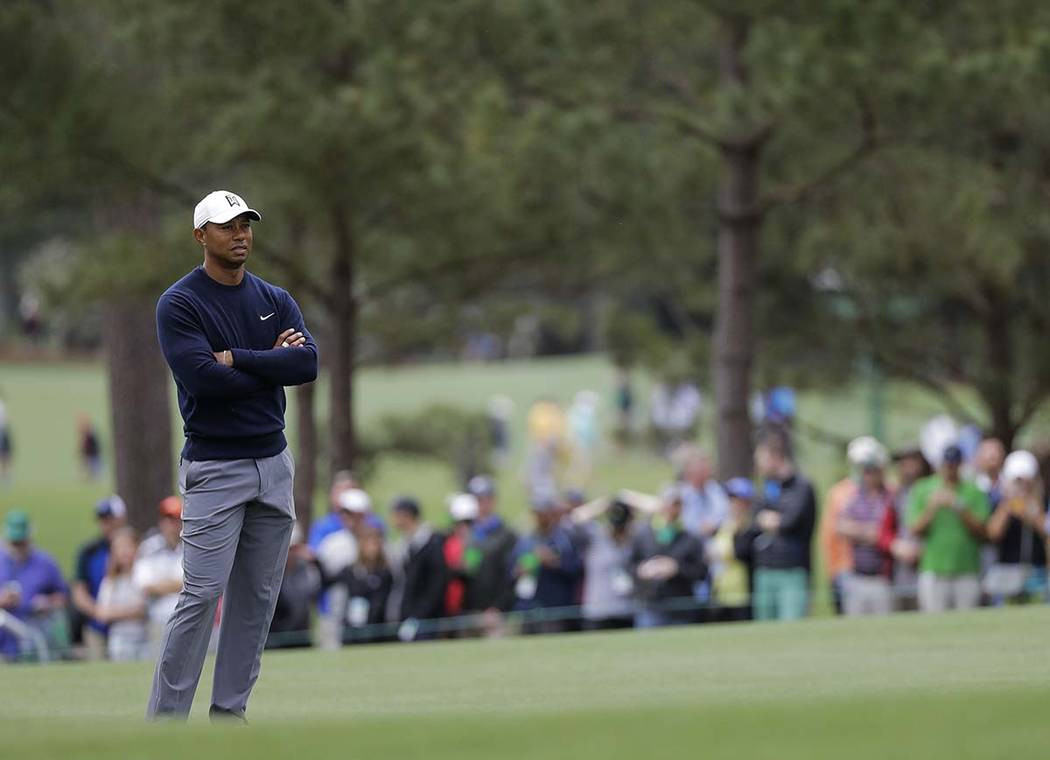 Tiger Woods waits to putt on the first hole during a practice round for the Masters golf tournament Wednesday, April 4, 2018, in Augusta, Ga. (Chris Carlson/AP)