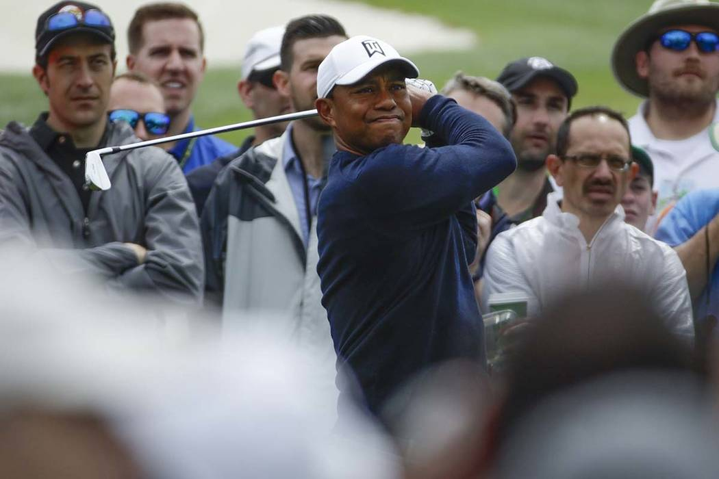 Tiger Woods hits from the third tee during a practice round for the Masters golf tournament Wednesday, April 4, 2018, in Augusta, Ga. (Chris Carlson/AP)