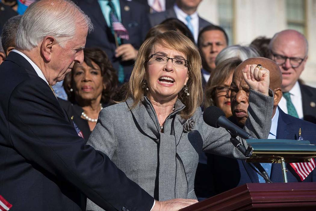 In this Wednesday, Oct. 4, 2017, file photo, former U.S. Rep. Gabby Giffords, of Arizona, who survived an assassination attempt in 2011, joins other Democrats in a call for action on gun safety le ...