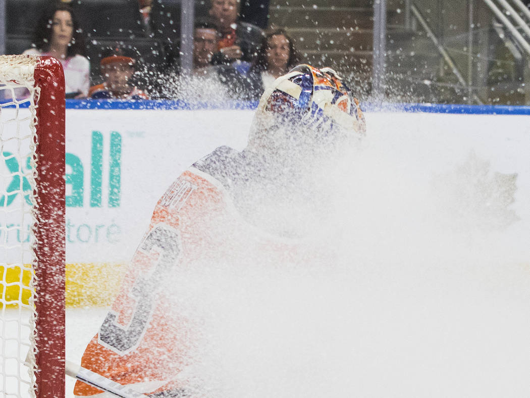 Edmonton Oilers goalie Cam Talbot (33) is snowed out during first-period NHL hockey game action against the Vegas Golden Knights in Edmonton, Alberta, Thursday, April 5, 2018. (Amber Bracken/The C ...