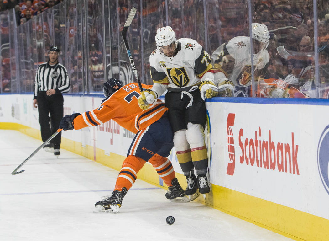 Vegas Golden Knights' Brandon Pirri (73) is checked by Edmonton Oilers' Ethan Bear (74) during first-period NHL hockey game action in Edmonton, Alberta, Thursday, April 5, 2018. (Amber Bracken/The ...