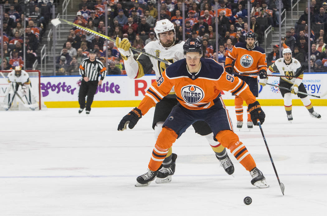 Vegas Golden Knights' Alex Tuch (89) chases Edmonton Oilers' Jesse Puljujarvi (98) during first-period NHL hockey game action in Edmonton, Alberta, Thursday, April 5, 2018. (Amber Bracken/The Cana ...
