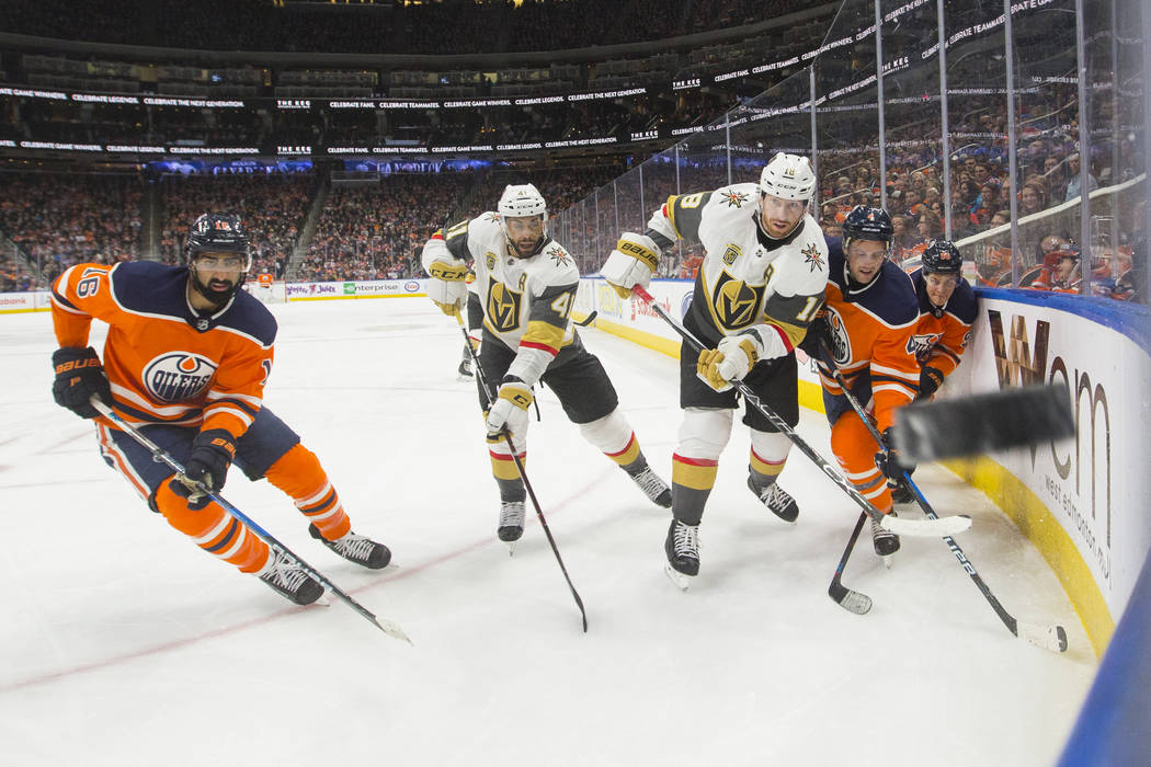 Vegas Golden Knights' Pierre-Edouard Bellemare (41) and teammate James Neal (18) watch the puck in the corner with Edmonton Oilers' Jujhar Khaira (16), Kris Russell (4) and Jesse Puljujarvi (98) d ...