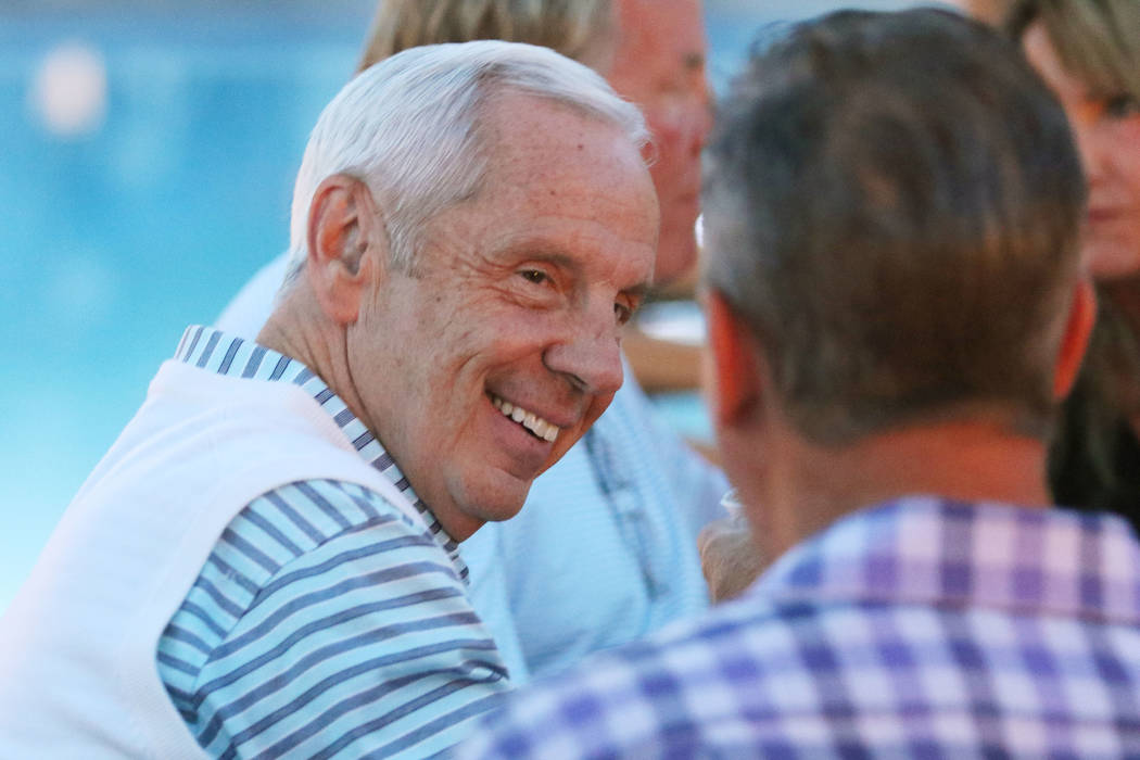 North Carolina coach Roy Williams, left, socializes during the 9th annual Coaches vs. Cancer Las Vegas Golf Classic hosted at MGM Grand Sunday, May 22, 2016, in Las Vegas. Ronda Churchill/Las Vega ...