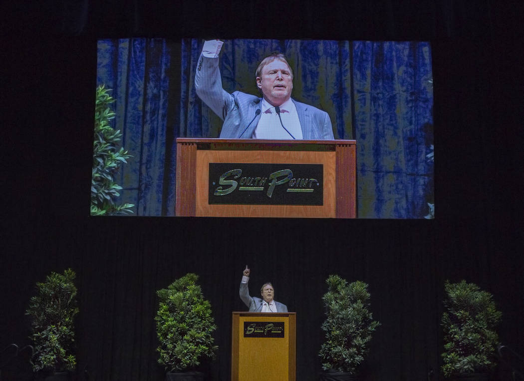 Mark Davis, owner and managing general partner of the Oakland Raiders, points to the sky to salute former local football great and Oakland Raider David Humm on Friday, April 6, 2018, at South Poin ...