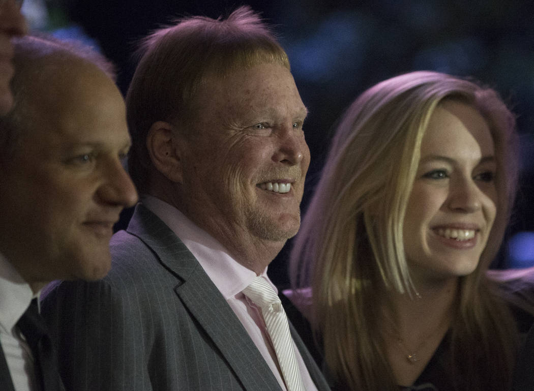 Marc Badain, left, president of the Oakland Raiders, Mark Davis, owner and managing general partner of the Oakland Raiders and Courtney Humm take a photo during a ceremony to celebrate the life of ...