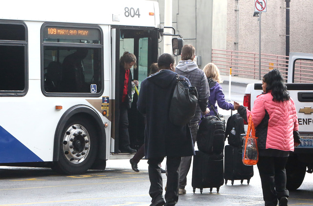 Arriving passengers board an RTC bus at Terminal One at McCarran International Airport Wednesday, Dec. 14, 2016, in Las Vegas. (Bizuayehu Tesfaye/Las Vegas Review-Journal)@bizutesfaye