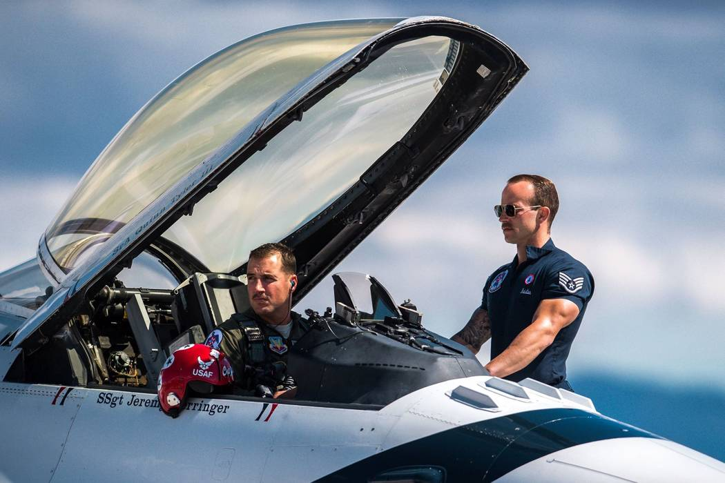 Maj. Stephen Del Bagno, Thunderbird 4/Slot Pilot, and Staff Sgt. Michael Meister, Thunderbird 4 Dedicated Crew Chief, await the signal to start their F-16 Fighting Falcon during a practice show at ...
