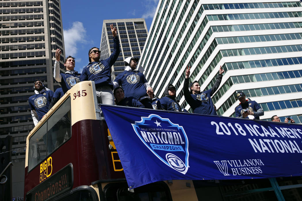 Members of the Villanova basketball team wave to fans during a parade celebrating their NCAA college basketball championship, Thursday, April 5, 2018, in Philadelphia. Villanova defeated Michigan  ...