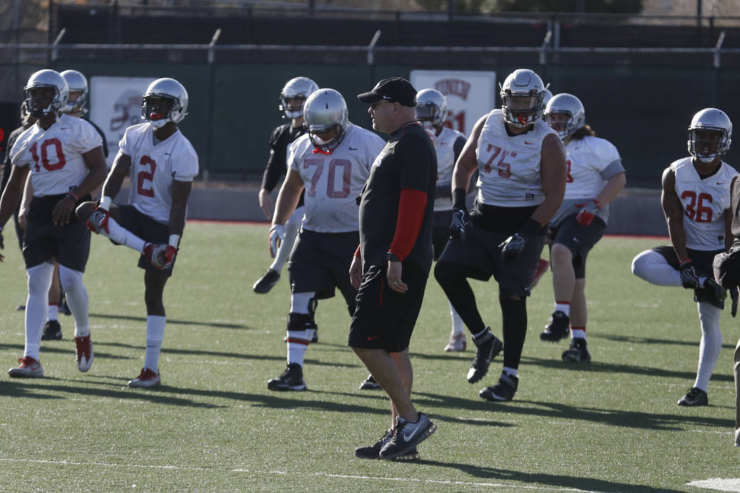 UNLV Rebels head coach Tony Sanchez watches as his players stretch during the first day of spring practice on Tuesday, March 6, 2018, in Las Vegas. Bizuayehu Tesfaye/Las Vegas Review-Journal @bizu ...