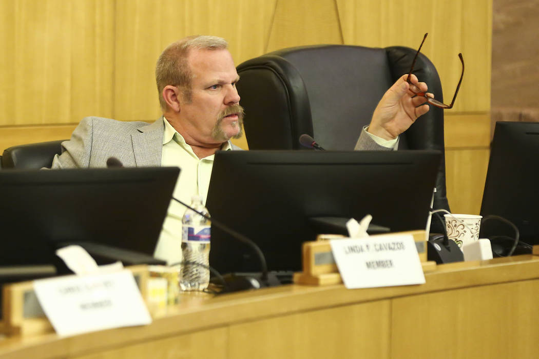 Clark County School District trustee Kevin Child reacts during a settlement case involving Child and Deputy Superintendent Kim Wooden during a CCSD Board of Trustees meeting at the County Governme ...
