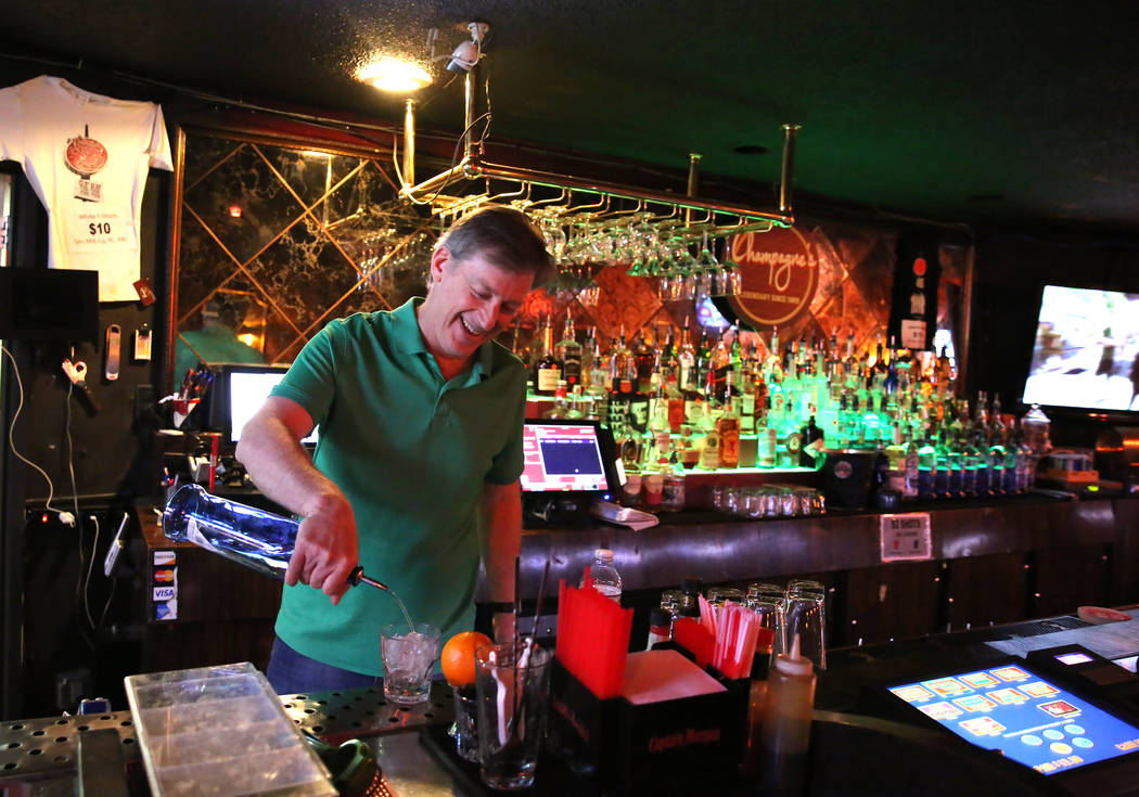Greg Sims, owner of Champagnes Cafe, pours drinks on Wednesday, April 25, 2018, in Las Vegas. Bizuayehu Tesfaye/Las Vegas Review-Journal @bizutesfaye