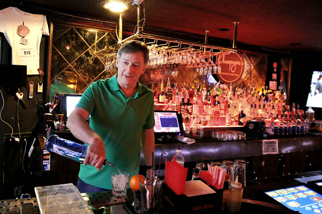 Greg Sims, owner of Champagnes Cafe, port drinks on Wednesday, April 25, 2018, in Las Vegas. Bizuayehu Tesfaye/Las Vegas Review-Journal @bizutesfaye