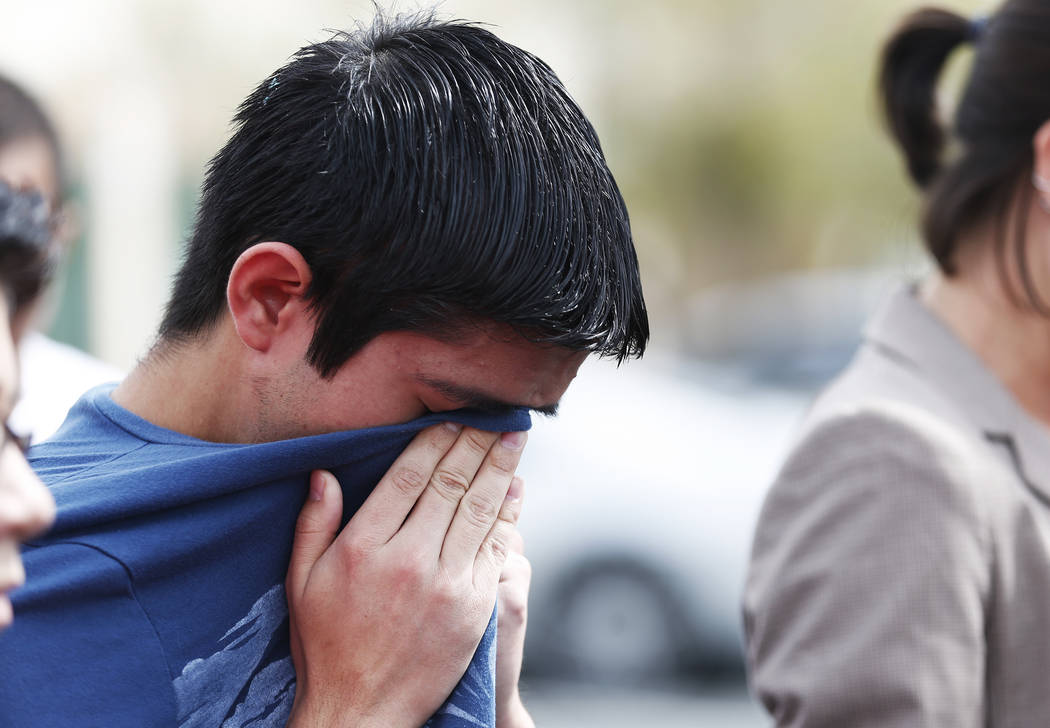 Ricardo Avelar-Gomez, 18, reacts while speaking about his mother, who was detained by Immigration and Customs Enforcement when she showed up to an appointment regarding legal permanent residence,  ...