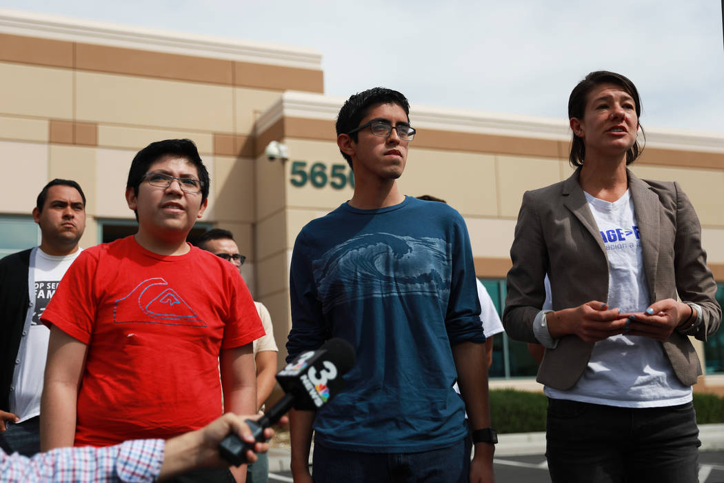 Eric Avelar-Gomez, 13, and his brother Ricardo, 18, stand next to Bliss Requa-Trautz as she talks about their mother,  who was detained by Immigration and Customs Enforcement when she showed up to ...