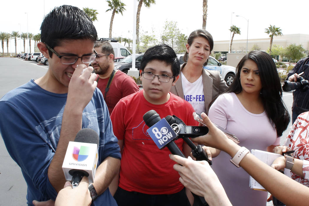 Ricardo Avelar-Gomez, 18, gets emotional as he speaks during a press conference as his brother Eric, 13, right, looks on outside of U.S. Citizen and Immigration Service building on Thursday, April ...