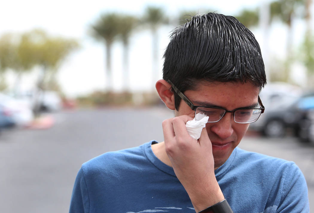 Ricardo Avelar, 18, gets emotional as he speaks during a press conference outside of U.S. Citizen and Immigration Service building on Thursday, April 5, 2018, in Las Vegas. Avelar's mother, Cecili ...