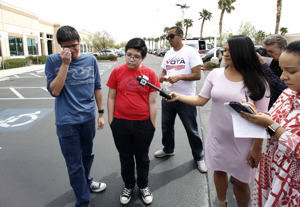 Ricardo Avelar, 18, gets emotional as he speaks during a press conference as his brother Eric, 13, right, looks on outside U.S. of Citizen and Immigration Service building on Thursday, April 5, 20 ...