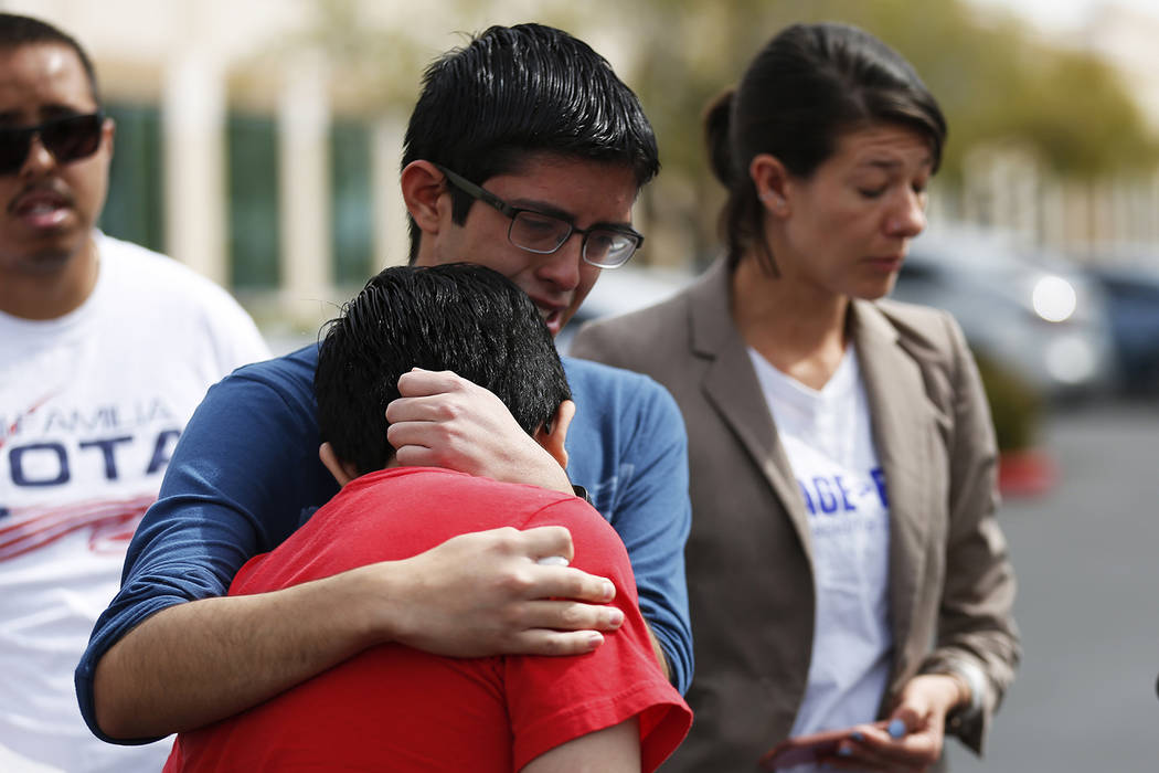 Ricardo Avelar-Gomez, 18, embraces his brother Eric, 13, after talking about their mother, who was detained by Immigration and Customs Enforcement when she showed up to an appointment regarding le ...