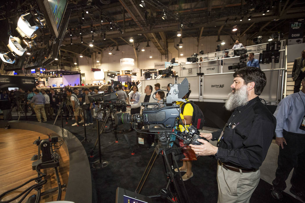Audio and lighting engineer Dan Stark of Kansas City checks out a camera at the Canon booth during the second day of the NAB Show at the Las Vegas Convention Center on Tuesday, April 10, 2018. Ric ...