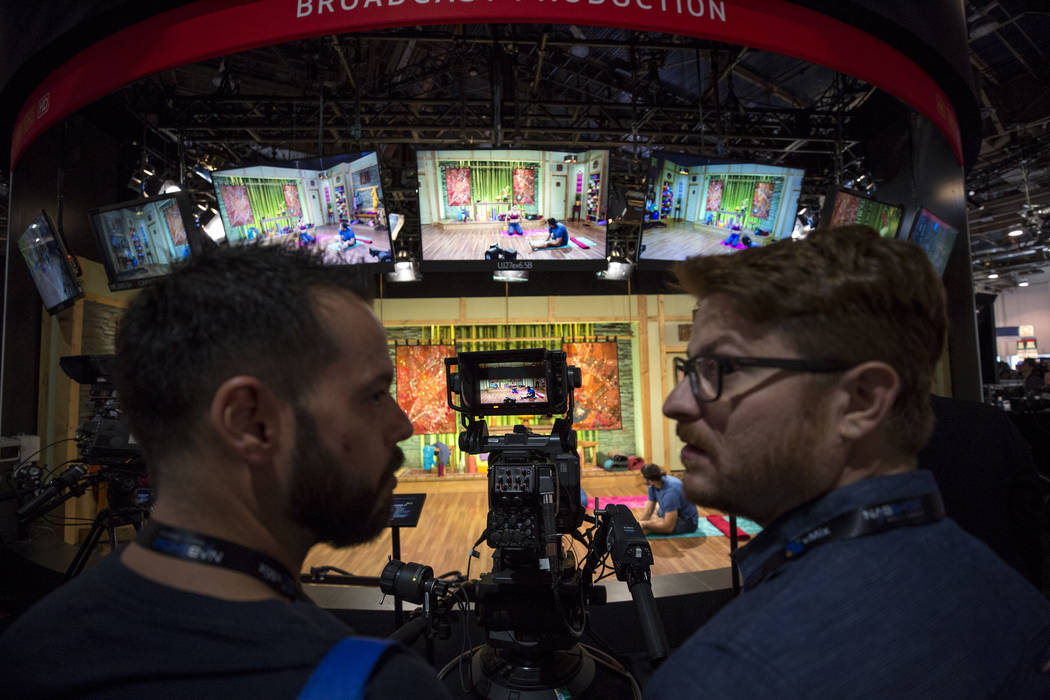 Show attendees check out Canon's 4K UHD Studio Box lens on display during the second day of the NAB Show at the Las Vegas Convention Center on Tuesday, April 10, 2018. Richard Brian Las Vegas Revi ...