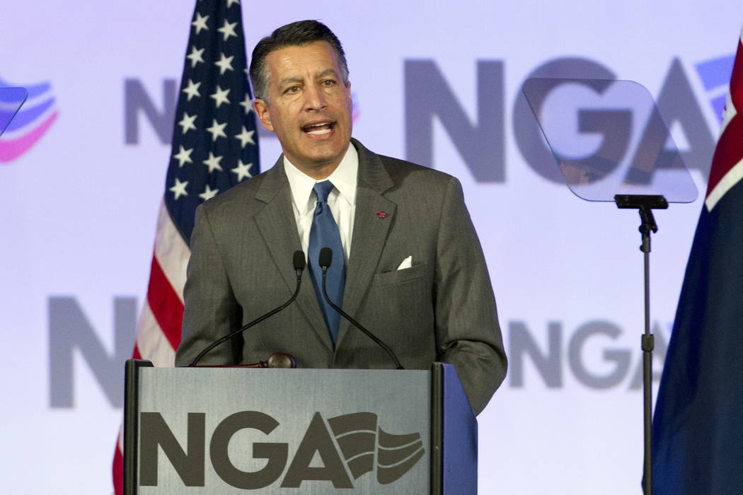 National Governors Association (NGA) Chair, Gov. Brian Sandoval of Nevada speaks during the National Governor Association 2018 winter meeting, on Saturday, Feb. 24, 2018, in Washington. (AP Photo/ ...