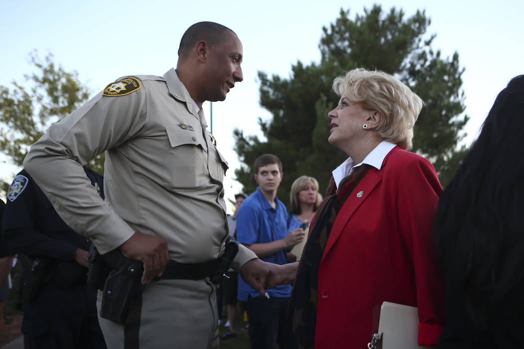 Deputy Chief Charles Hank, left, and Mayor Carolyn Goodman before the start of a candlelight vigil for Las Vegas police officer Charleston Hartfield, who was killed while off-duty in the Oct. 1 ma ...