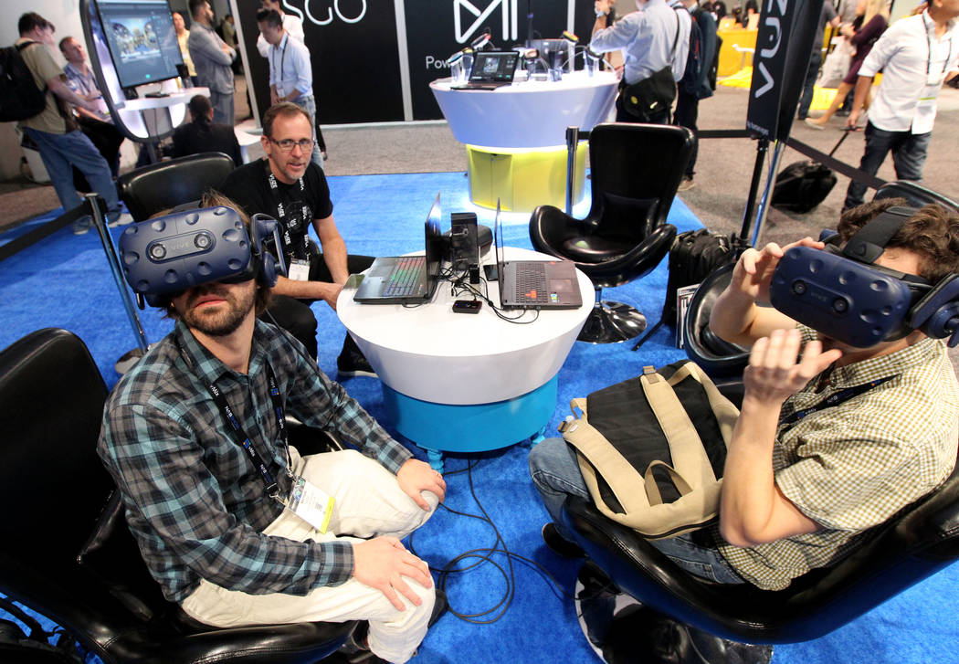 Matthew Celia of Light Sale VR, left, and Nathan Cohen of Florida State University check out virtual reality content at the Humaneyes Technologies booth the National Association of Broadcasters Sh ...