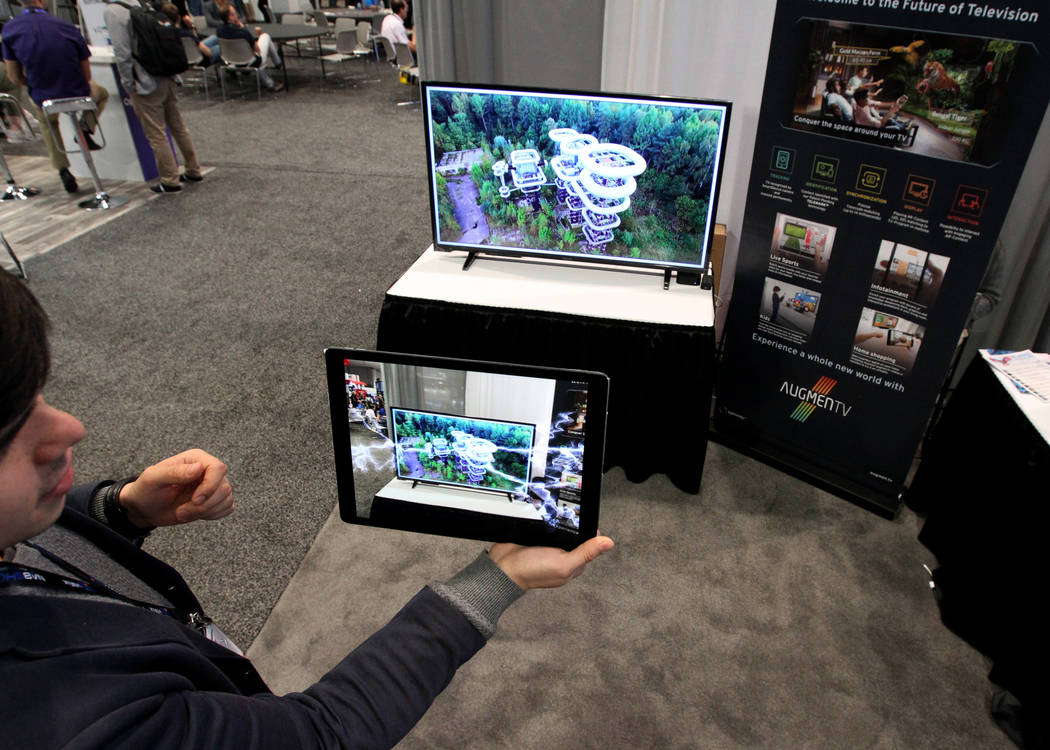 Robin Sho Moser, CEO and co-founder of eyecandylab shows augmented reality during the National Association of Broadcasters Show at the Las Vegas Convention Center Wednesday, April 11, 2018. K.M. C ...