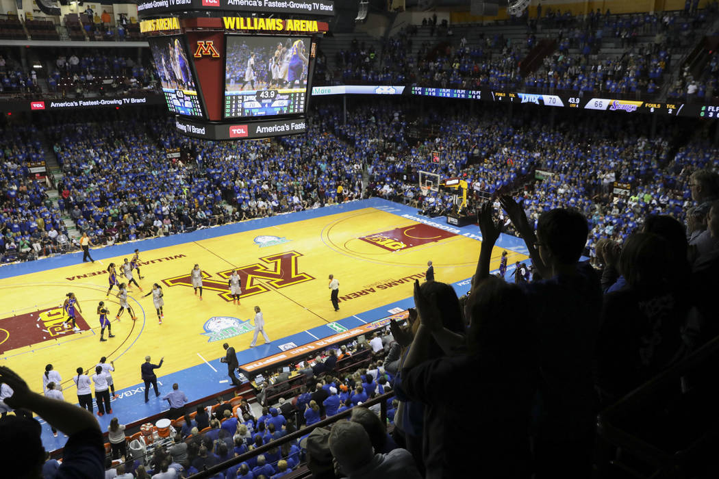 Fans cheer during the second half of Game 2 of the WNBA finals between the Los Angeles Sparks and the Minnesota Lynx on Tuesday, Sept. 26, 2017, in Minneapolis. The Lynx won 70-68. The Lynx were t ...
