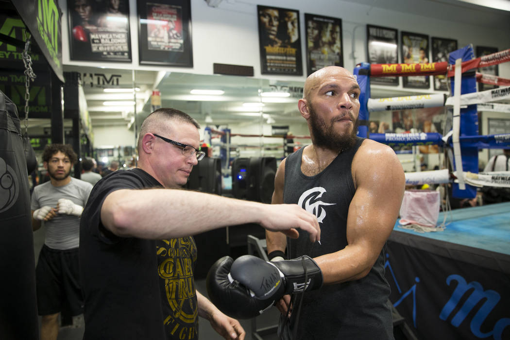 Boxing promoter Tony Grygelko helps Caleb Truax remove his gloves during media day at the Mayweather Boxing Club in Las Vegas, Wednesday, April 4, 2018.  Erik Verduzco Las Vegas Review-Journal @Er ...