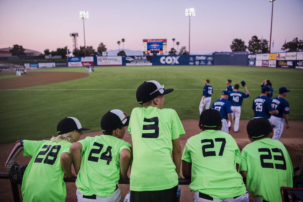 A group of baseball players watch the team warm up at Cashman Field on Saturday, Sep. 2, 2017, in Las Vegas. Morgan Lieberman Las Vegas Review-Journal