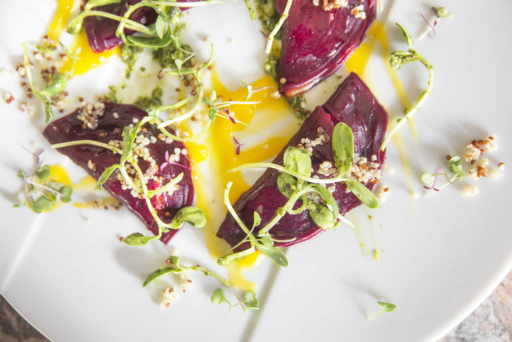 Roasted beet ravioli with tri color quinoa ragout, sweet basil watercress pistou and zucchini flower at T-Bones Chophouse on Monday, April 9, 2018, at Red Rock hotel-casino, in Las Vegas.  Benjami ...