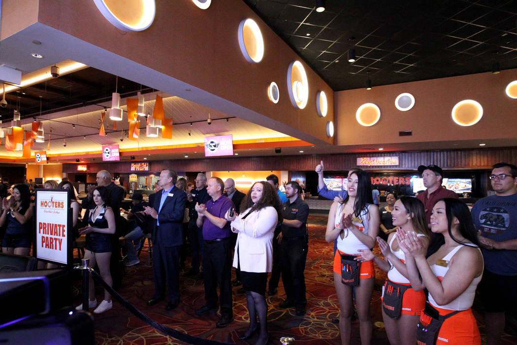 Workers and guests take in the festivities for the grand opening of Steak 'n Shake inside Hooters Hotel Thursday, April 5, 2018. The restaurant, just inside the main entrance, is touted as the lar ...