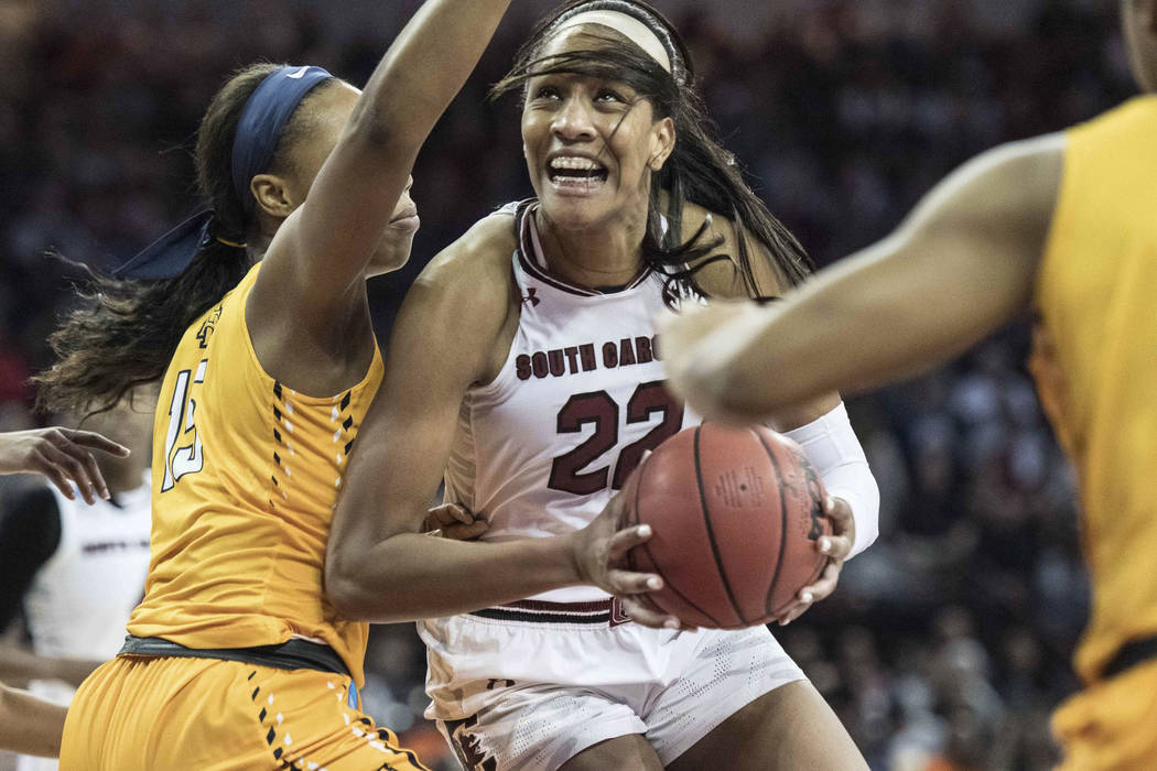 South Carolina forward A'ja Wilson, right, drives to the hoop against North Carolina A&T center Alexis Lessears, left, during the first half of game in the first-round of the NCAA women's coll ...