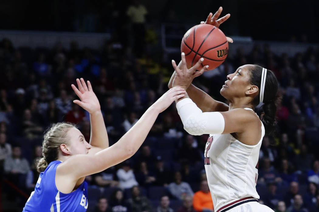Buffalo's Katherine Ups (5) defends against South Carolina's A'ja Wilson (22) during the first half in a regional semifinal at the NCAA women's college basketball tournament Saturday, March 24, 20 ...