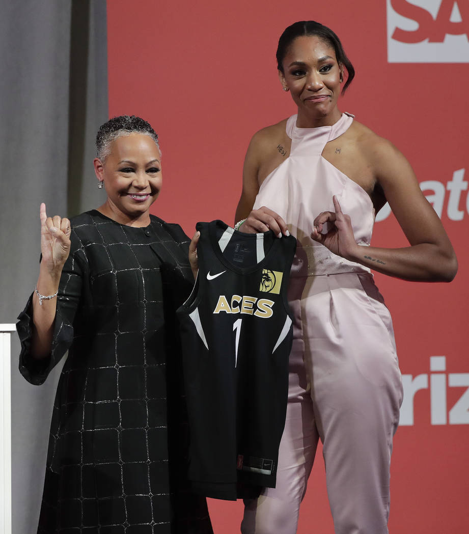 South Carolina's A'ja Wilson, right, poses for a photo with WNBA President Lisa Borders after being selected as the No. 1 overall pick by the Las Vegas Aces in the WNBA basketball draft, Thursday, ...