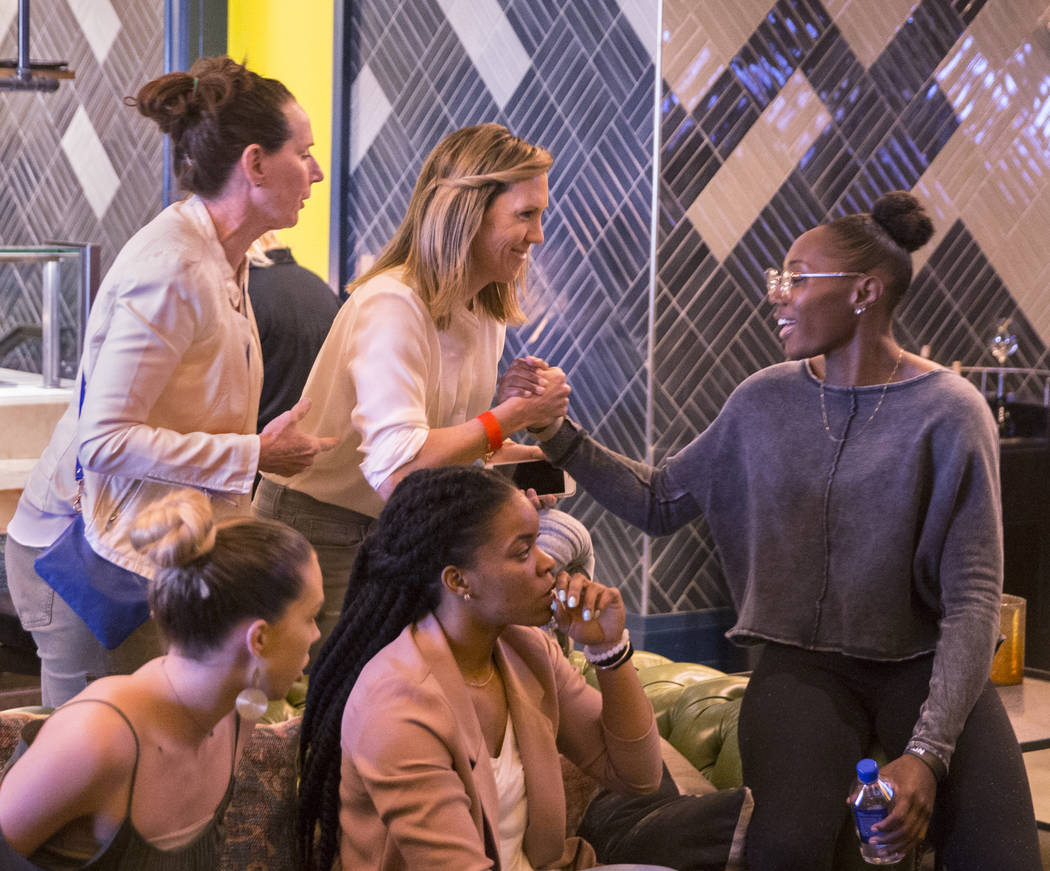 Las Vegas Aces guard Sequoia Holmes, right, greets UNLV coaches Caitlin Collier and Kathy Olivier during a WNBA draft party hosted by the Aces at Libertine Social on Thursday, April 12, 2018, at t ...