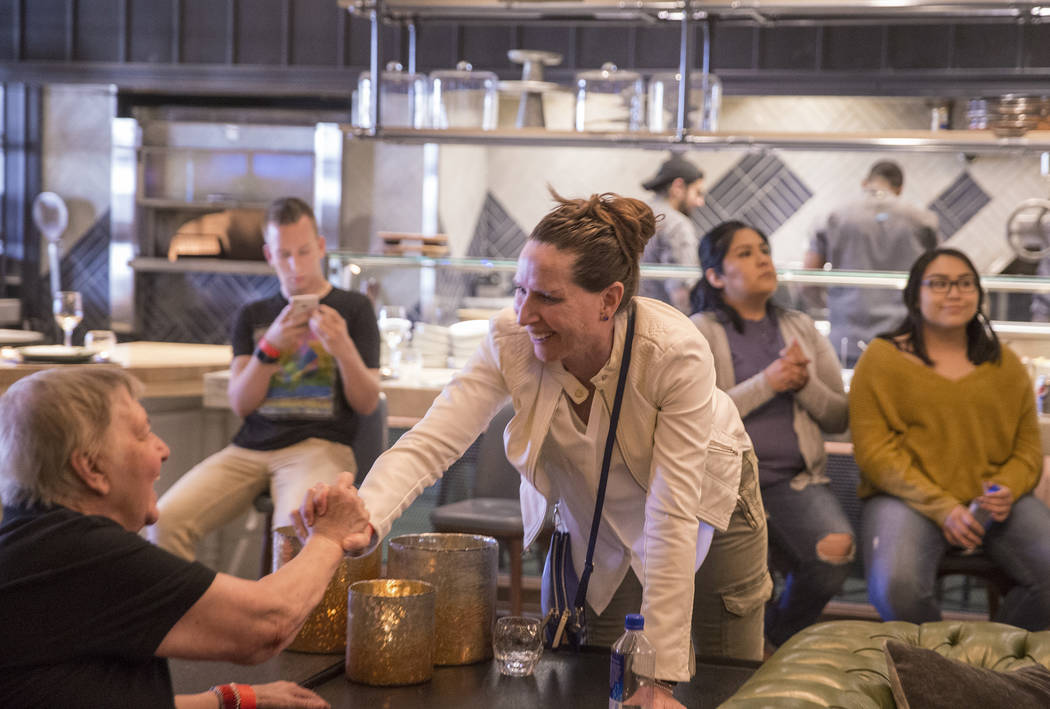 UNLV head coach Kathy Olivier, right, greets fans during a WNBA draft party hosted by the Las Vegas Aces at Libertine Social on Thursday, April 12, 2018, at the Mandalay Bay hotel-casino, in Las V ...
