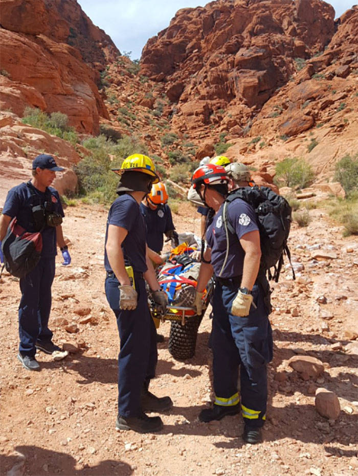 Crews remove a man who had fallen about 50 feet at Red Rock Canyon on Thursday. (Las Vegas Fire & Rescue via Twitter)