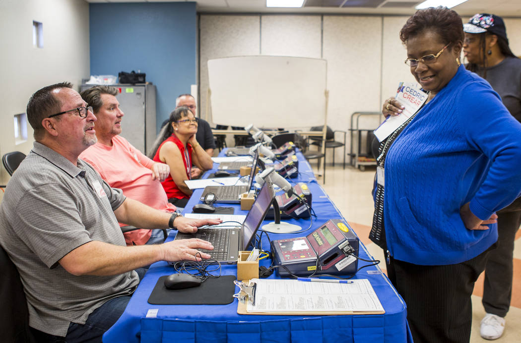 Belinda Wilson of Las Vegas, right, checks in with official representative Larry Magnelli during voting for the Ward 5 Las Vegas City Council special election at the Doolittle Community Center in  ...