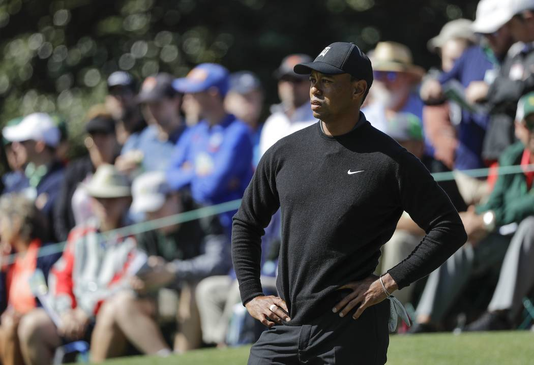Tiger Woods waits to putt on the first hole during the first round at the Masters golf tournament Thursday, April 5, 2018, in Augusta, Ga. (AP Photo/David J. Phillip)