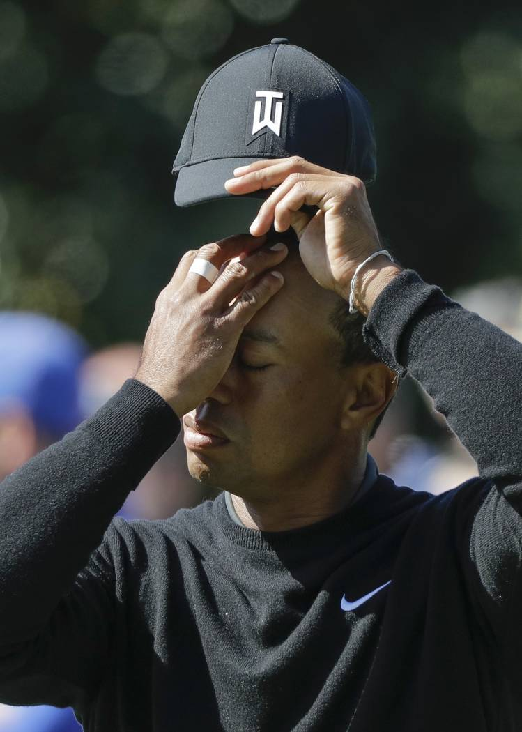 Tiger Woods reacts on the first green during the first round at the Masters golf tournament Thursday, April 5, 2018, in Augusta, Ga. (AP Photo/David J. Phillip)