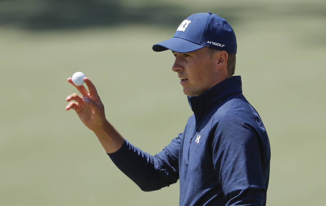 Jordan Spieth reacts after putting on the second hole during the first round at the Masters golf tournament Thursday, April 5, 2018, in Augusta, Ga. (AP Photo/David Goldman)