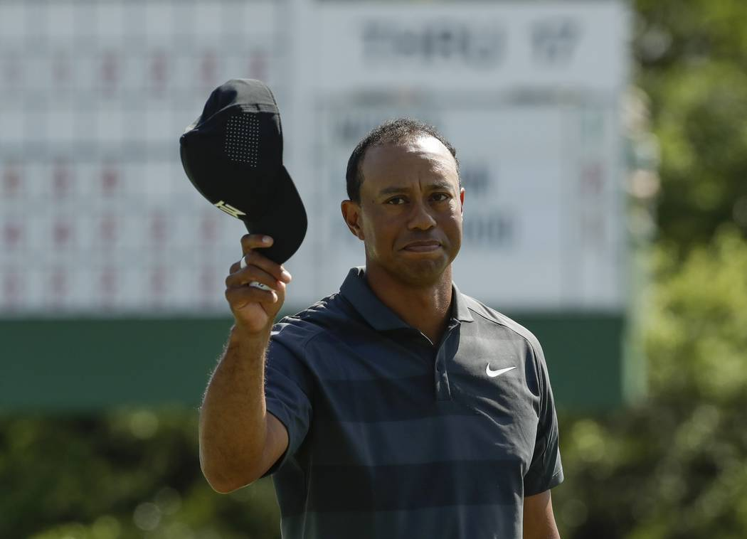 Tiger Woods tips his hat on the 18th hole during the first round at the Masters golf tournament Thursday, April 5, 2018, in Augusta, Ga. (AP Photo/Chris Carlson)