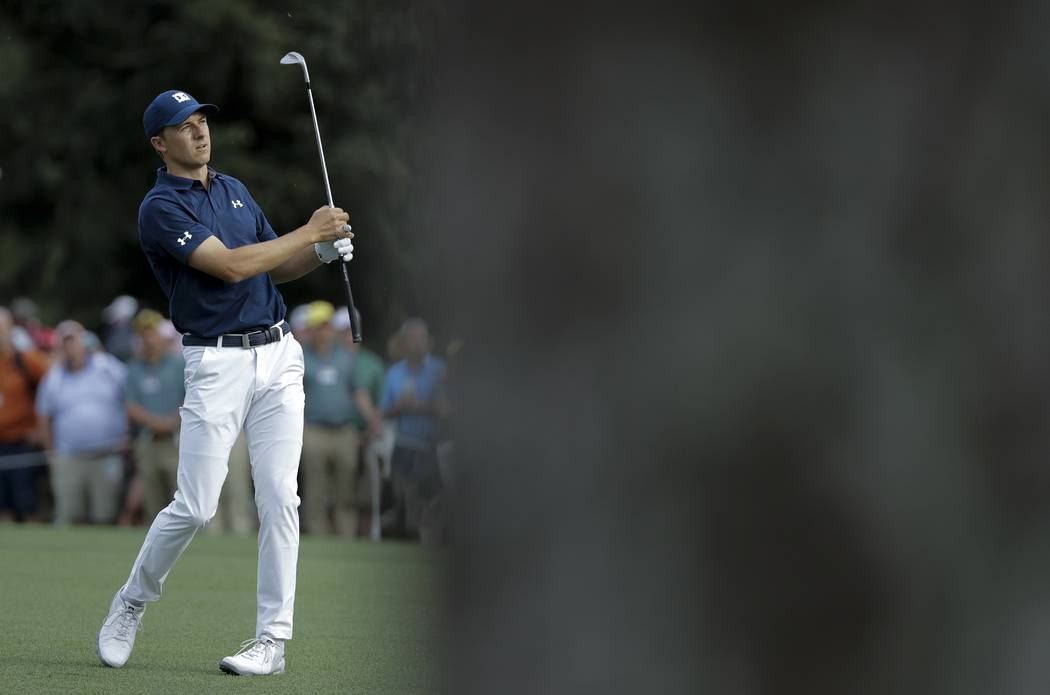 Jordan Spieth hits a shot on the 15th hole during the first round at the Masters golf tournament Thursday, April 5, 2018, in Augusta, Ga. (AP Photo/David J. Phillip)