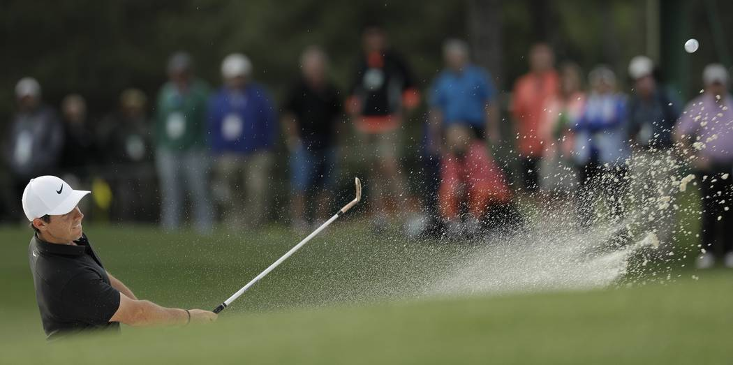 Rory McIlroy, of Northern Ireland, hits from a bunker on the 17th hole during the first round at the Masters golf tournament Thursday, April 5, 2018, in Augusta, Ga. (AP Photo/David J. Phillip)
