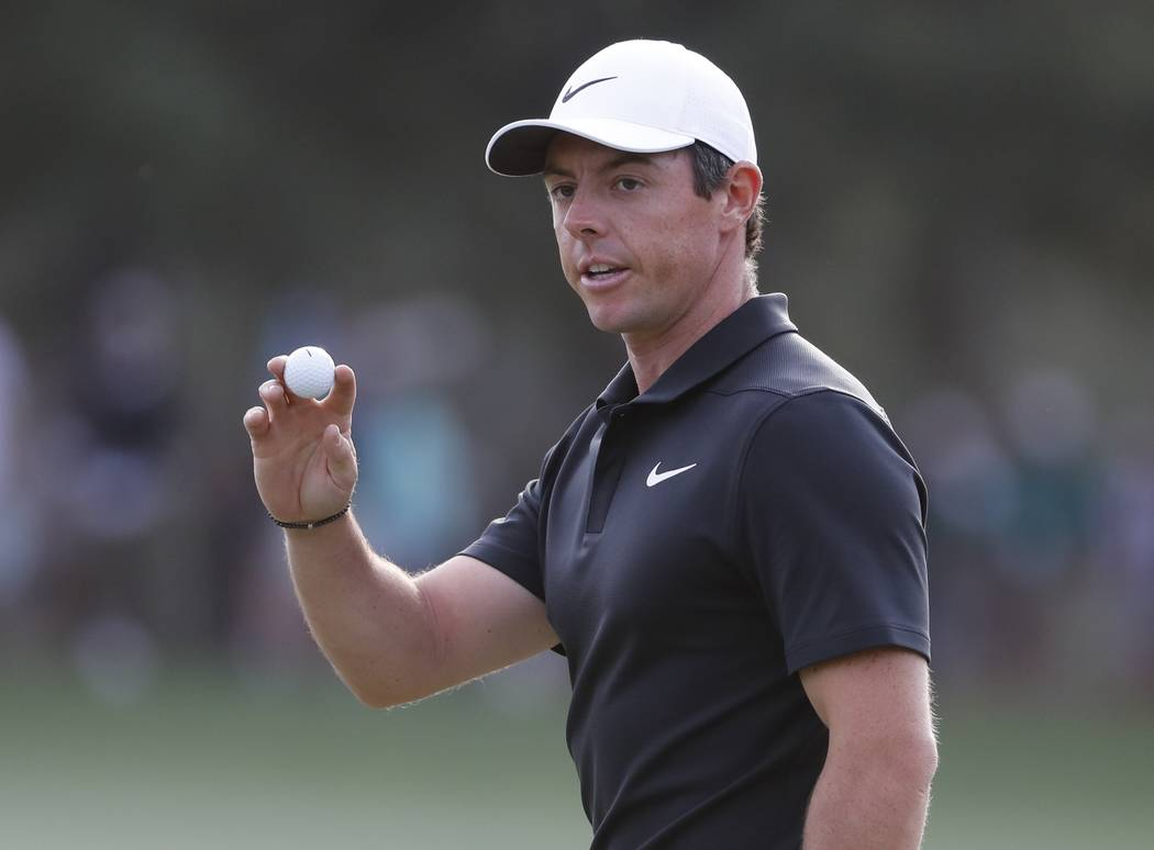 Rory McIlroy, of Northern Ireland, reacts to his putt on the 17th hole during the first round at the Masters golf tournament Thursday, April 5, 2018, in Augusta, Ga. (AP Photo/David Goldman)