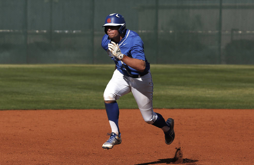 Bishop Gorman's first baseman Christian Lamar (24) runs towards third base against Clearfield at Bishop Gorman High School in Las Vegas on Thursday, April 5, 2018. Andrea Cornejo Las Vegas Review- ...