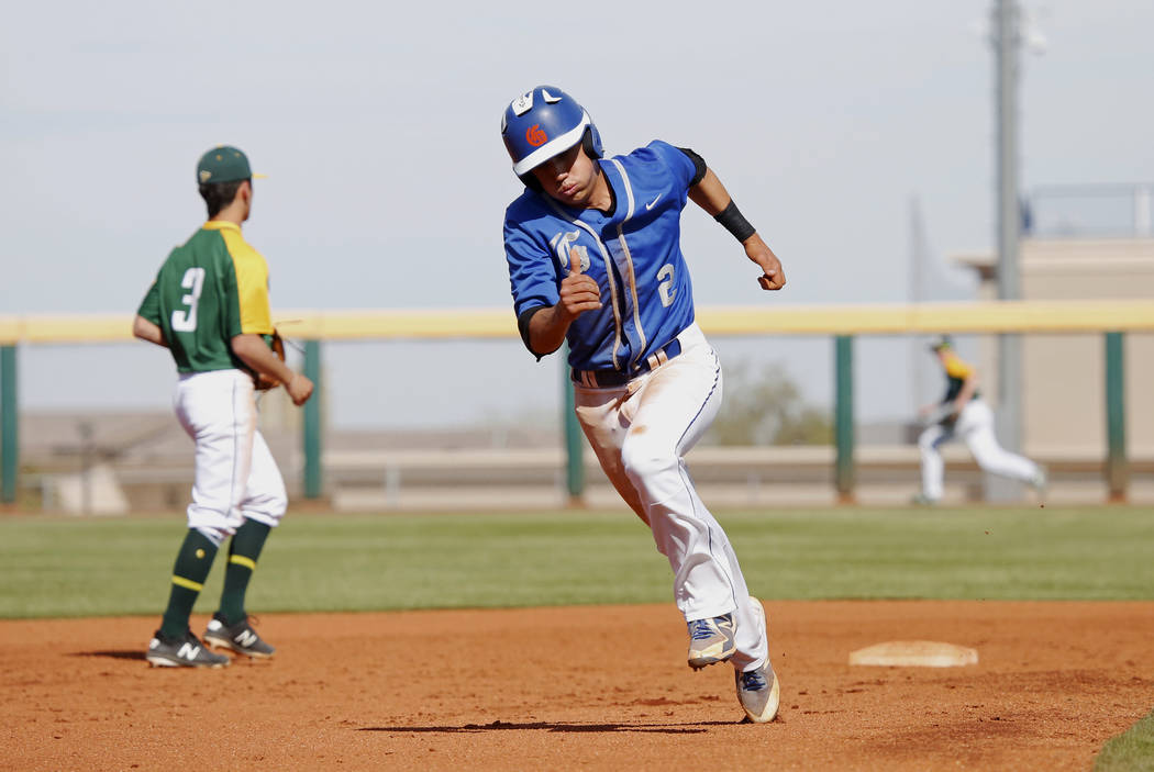 Bishop Gorman's shortstop Tyler Curtis (2) runs towards third base against Clearfield at Bishop Gorman High School in Las Vegas on Thursday, April 5, 2018. Andrea Cornejo Las Vegas Review-Journal  ...